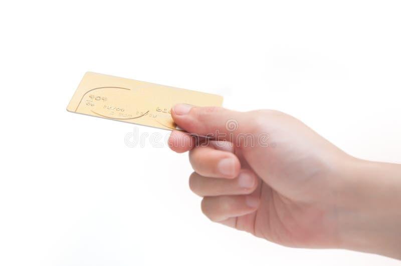 Gouden Creditcard in Menselijke Hand royalty-vrije stock afbeeldingen