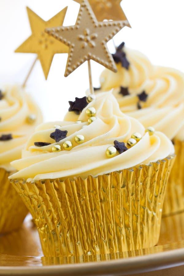 Gouden cupcakes royalty-vrije stock afbeelding