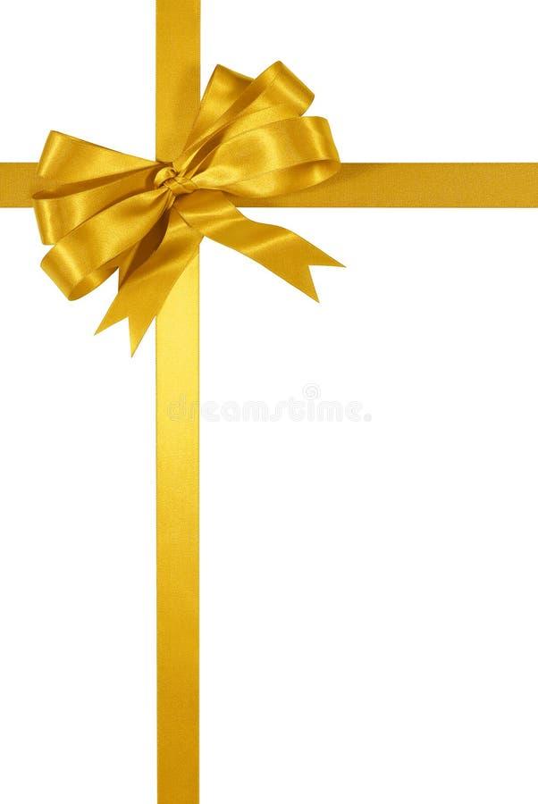Gouden die het lintboog van de Kerstmisgift op witte verticaal wordt geïsoleerd als achtergrond royalty-vrije stock afbeeldingen
