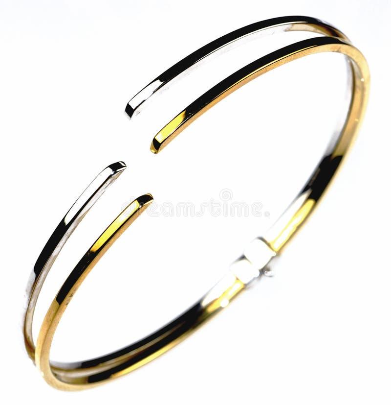 Gouden en zilveren armband stock fotografie