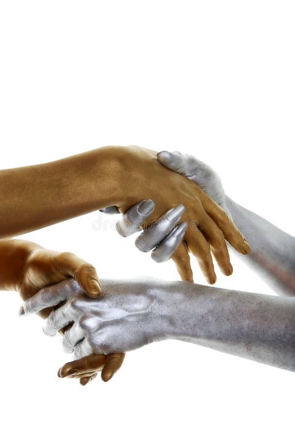 Gouden en zilveren handen stock afbeelding