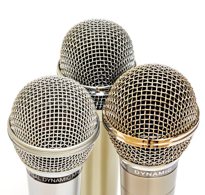 Gouden en zilveren microfoons stock fotografie