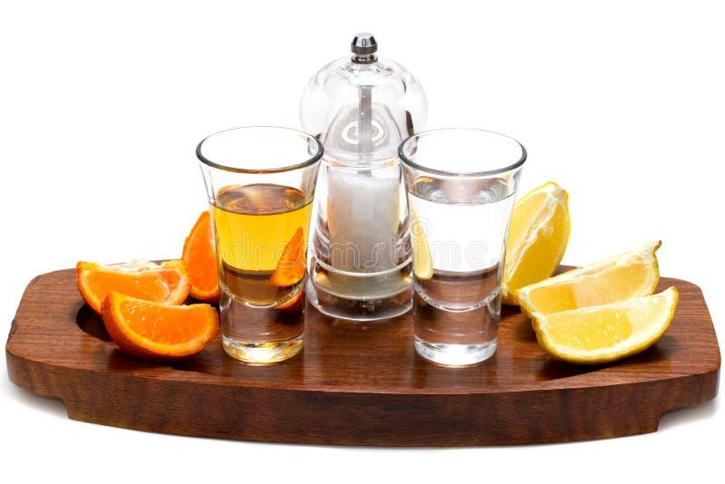 Gouden en zilveren tequila stock foto's