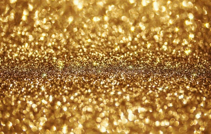 Gouden feestelijke glanzende achtergrond van heldere vonken en s royalty-vrije stock afbeelding