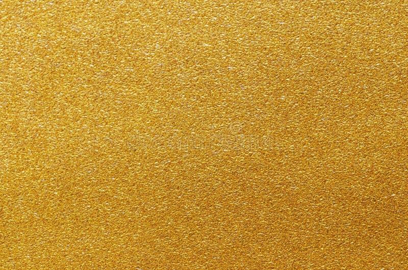 Gouden folie of metaaltextuur Abstracte metaalachtergrond royalty-vrije stock afbeeldingen