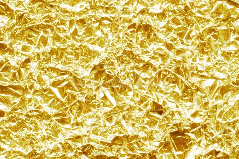 Gouden folietextuur als achtergrond royalty-vrije stock foto's
