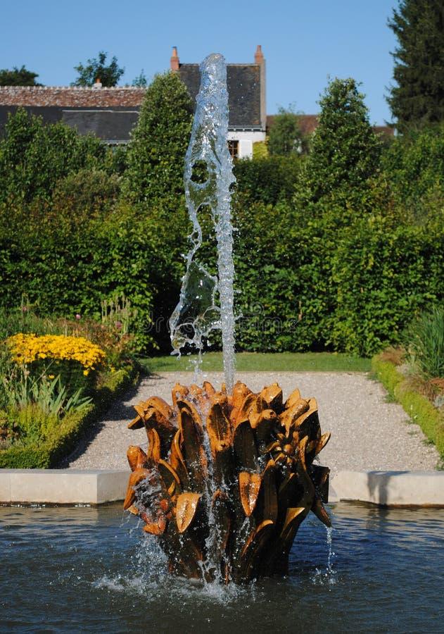 Gouden fontein stock afbeelding