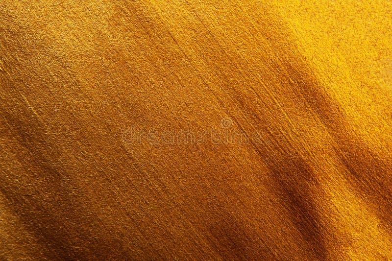 Gouden geschilderde textuur decoratieve achtergrond Heldere Macro phot royalty-vrije stock foto