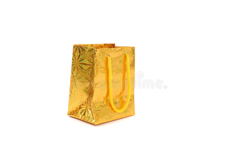 Gouden giftpakket stock afbeeldingen