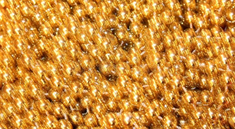 Gouden glanzend schittert achtergrond royalty-vrije stock afbeeldingen