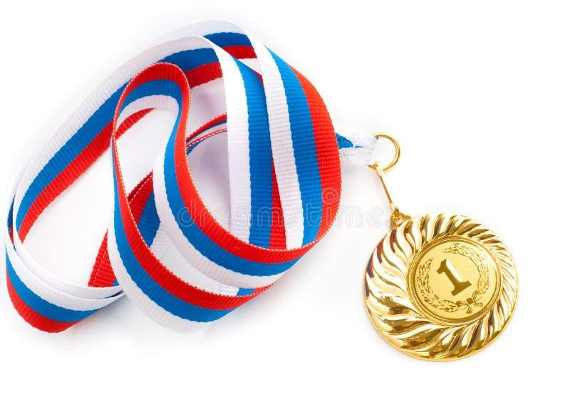 Gouden of gouden medaille geïsoleerden close-up stock afbeeldingen