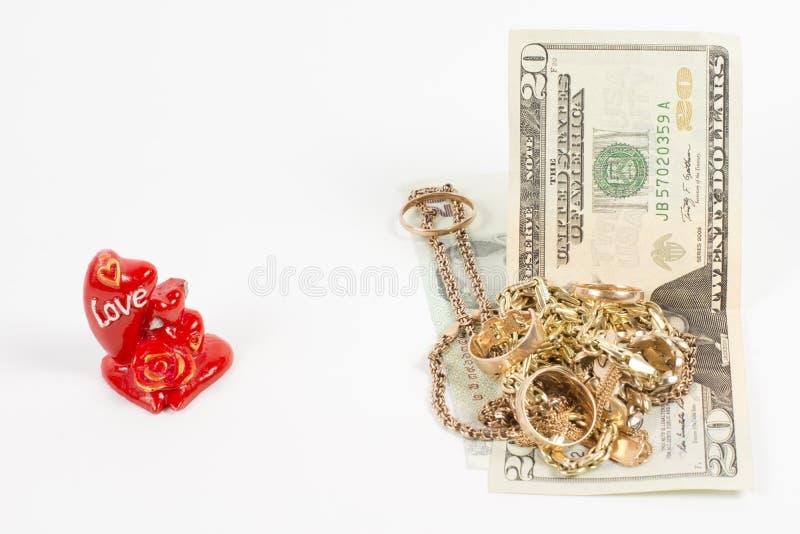 Gouden juwelen, liefde en geld stock afbeelding