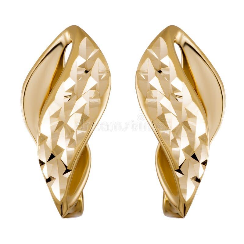 Gouden juwelenoorringen stock afbeeldingen