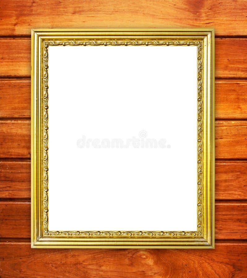 Gouden kader op houten muurachtergrond stock fotografie