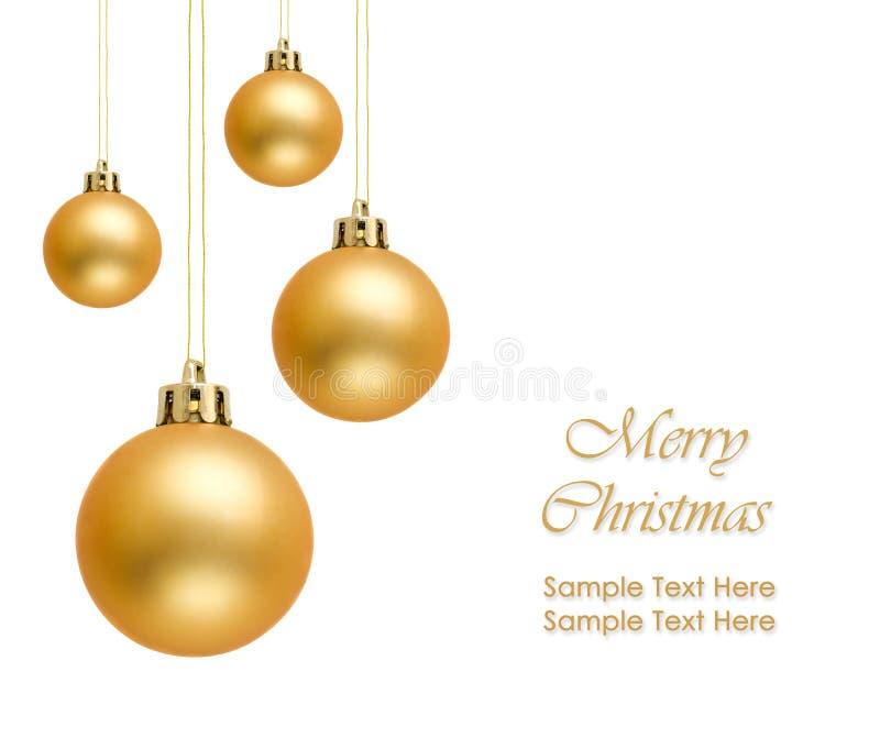 Gouden Kerstmisballen over witte achtergrond royalty-vrije stock foto