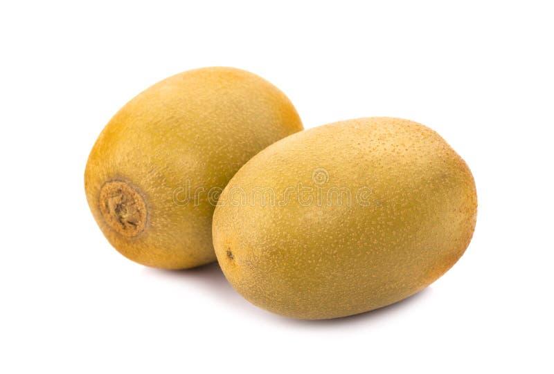Gouden kiwienfruit op een witte achtergrond stock foto's