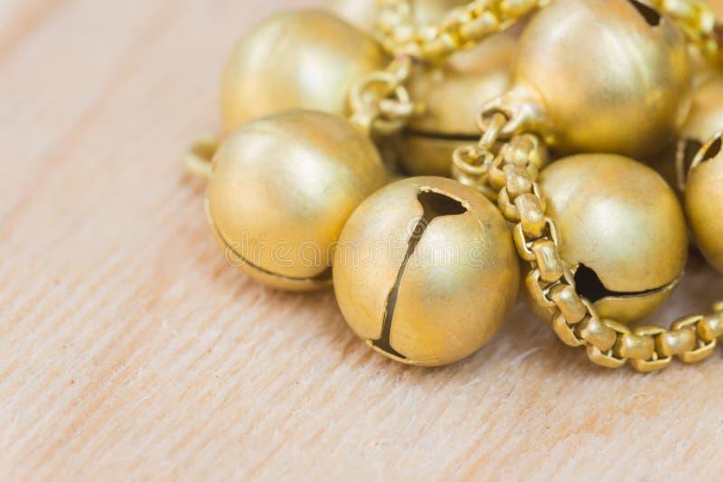 Gouden kleine klokken royalty-vrije stock foto's