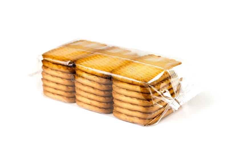 Gouden koekjes in een transparant pakket Sluit omhoog Op witte achtergrond royalty-vrije stock foto