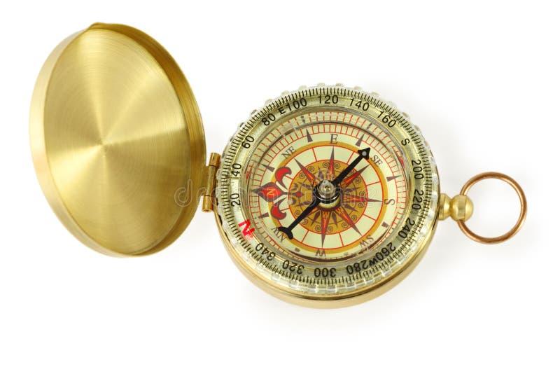 Gouden kompas met zwarte naald stock foto