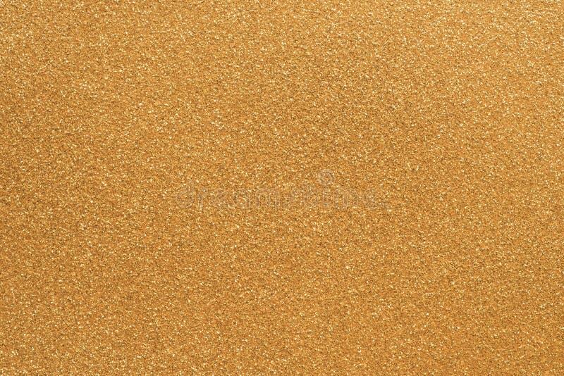 Gouden korrelige document textuur als achtergrond royalty-vrije stock afbeeldingen