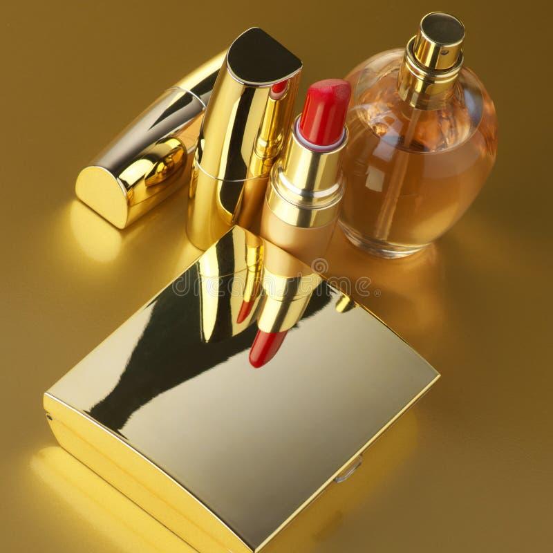 Gouden kosmetische reeks royalty-vrije stock afbeelding