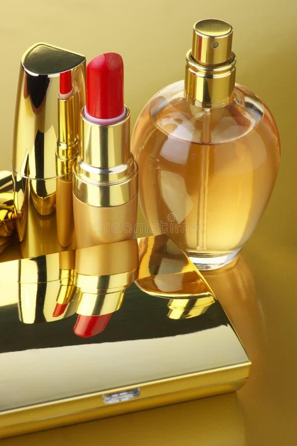 Gouden kosmetische reeks stock foto
