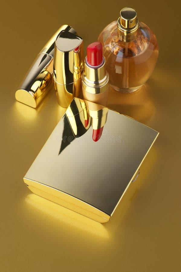 Gouden kosmetische reeks stock foto's