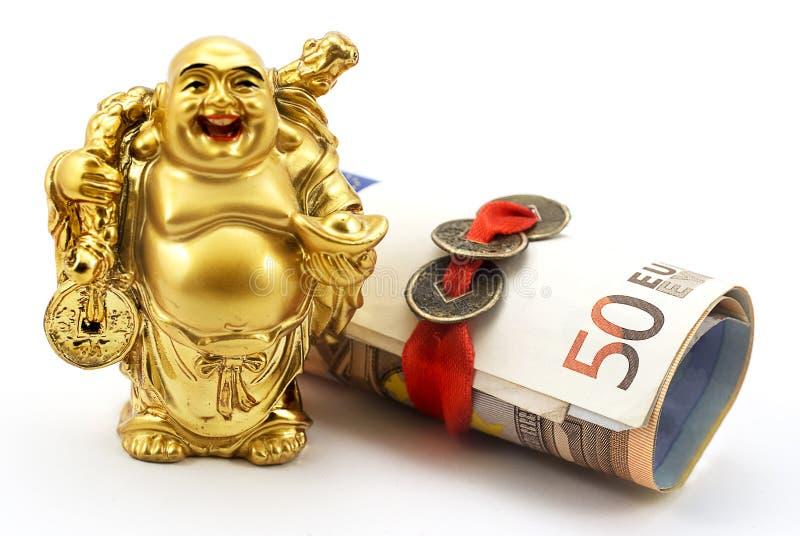 Gouden lachende Boedha met geld en Chinese muntstukken royalty-vrije stock foto's