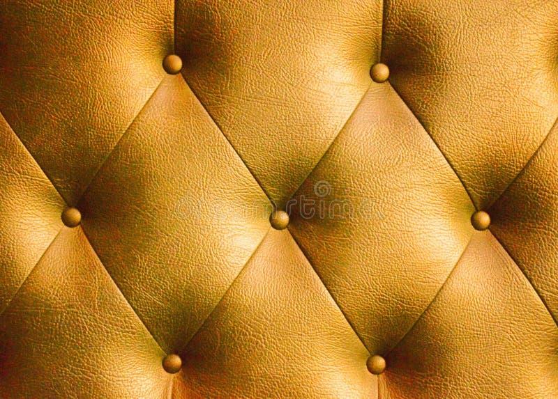 Gouden leerachtergrond stock afbeeldingen