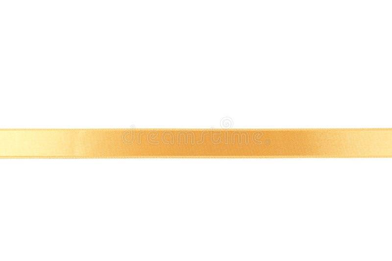 Gouden lint op een witte achtergrond stock fotografie