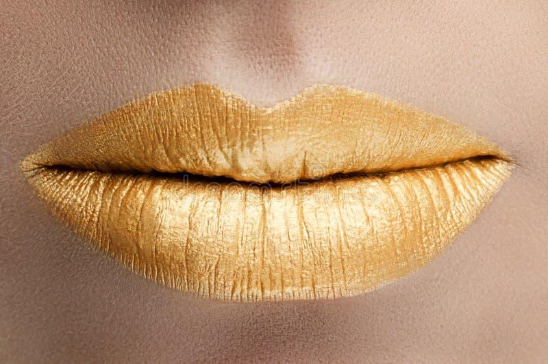 Gouden lippen royalty-vrije stock afbeeldingen
