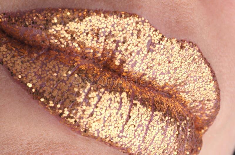 Gouden lippen stock foto's