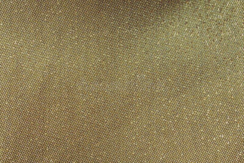 Gouden loopvlak op stof, gouden luxeachtergrond stock foto's