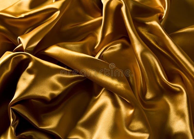 Gouden luxesatijn royalty-vrije stock afbeeldingen