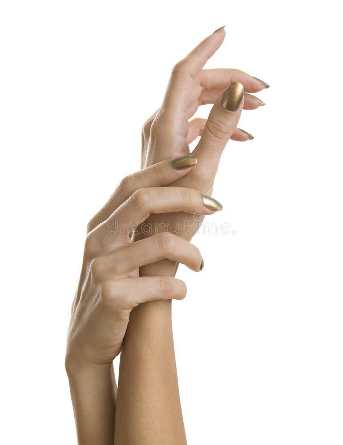 Download Gouden Manicure, Vrouwelijke Handen Met Glanzend Gouden Nagellak Stock Foto - Afbeelding bestaande uit gouden, boog: 54084574
