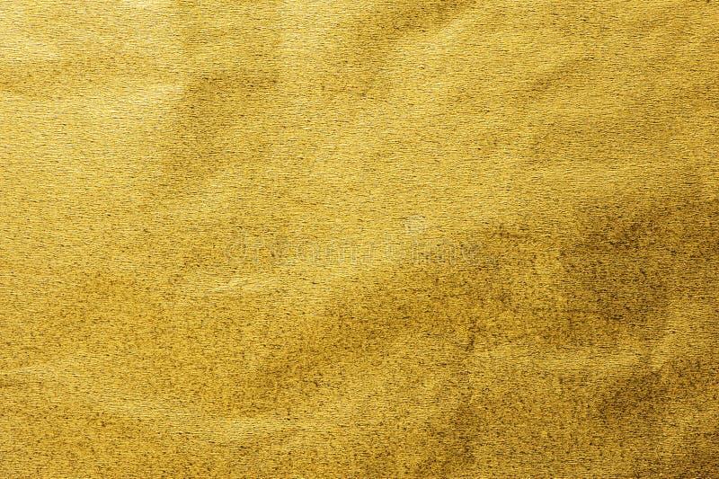 Gouden metaal het verpakkende document van het folieblad glanzende textuurachtergrond stock fotografie