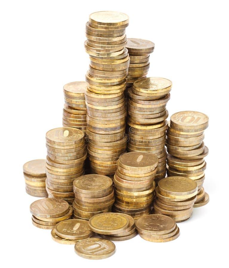 Gouden muntstuktorens op wit royalty-vrije stock fotografie