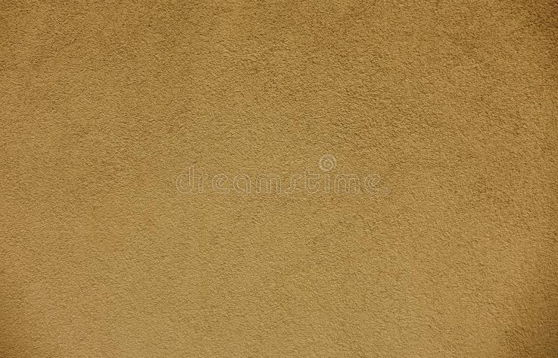 Gouden muurtextuur en achtergronden stock foto
