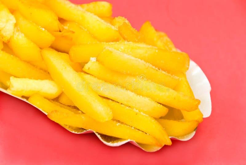 Gouden, omhoog gefrituurd - Franse fries.close royalty-vrije stock afbeelding
