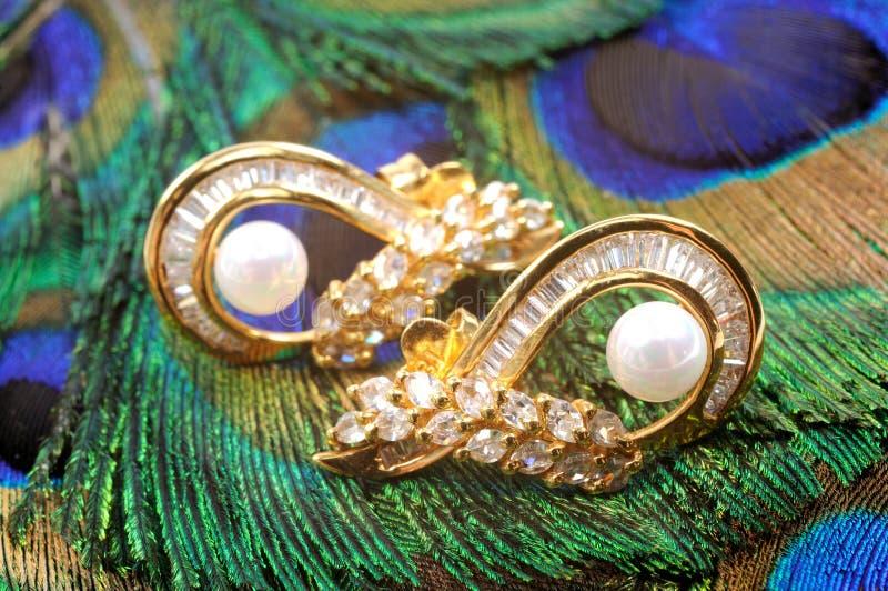 Gouden oorringen stock foto's
