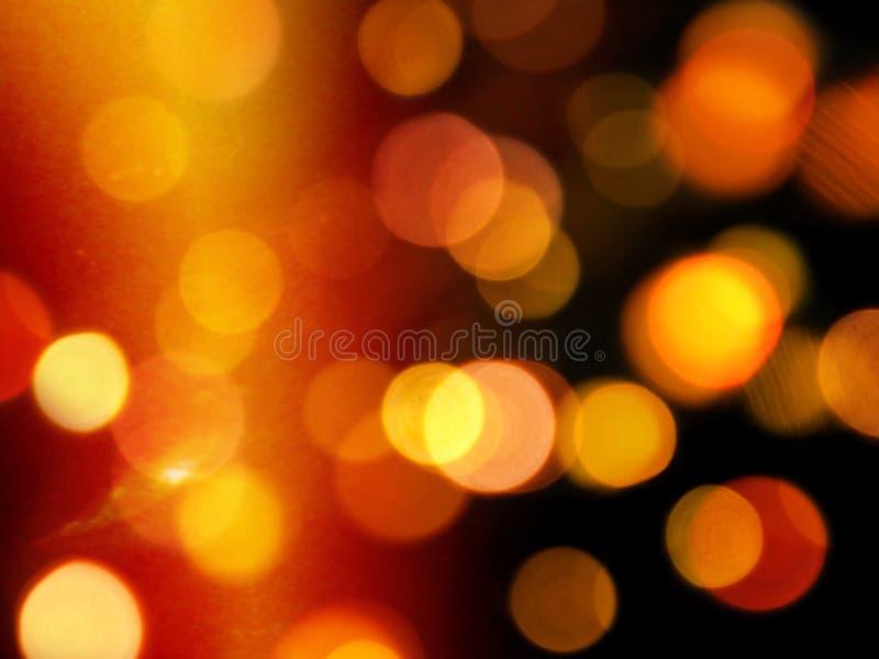 Gouden oranje gloed met ronde vage lichtenachtergrond stock afbeeldingen