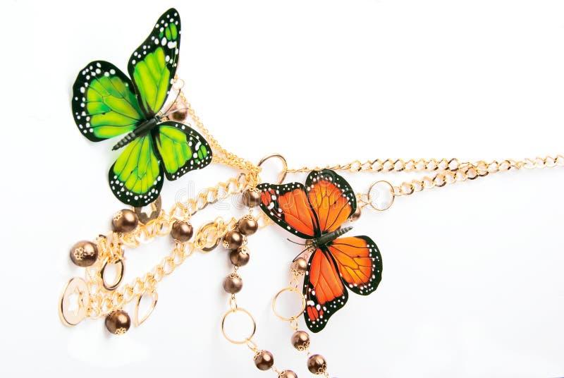 Gouden parels met vlinder stock fotografie