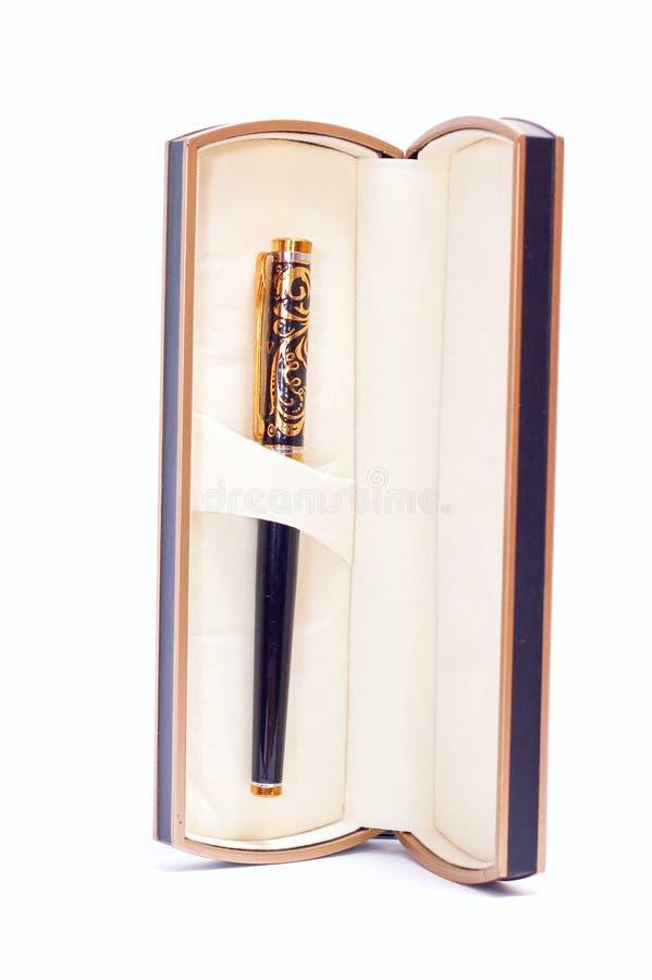 Gouden pen in doos royalty-vrije stock fotografie