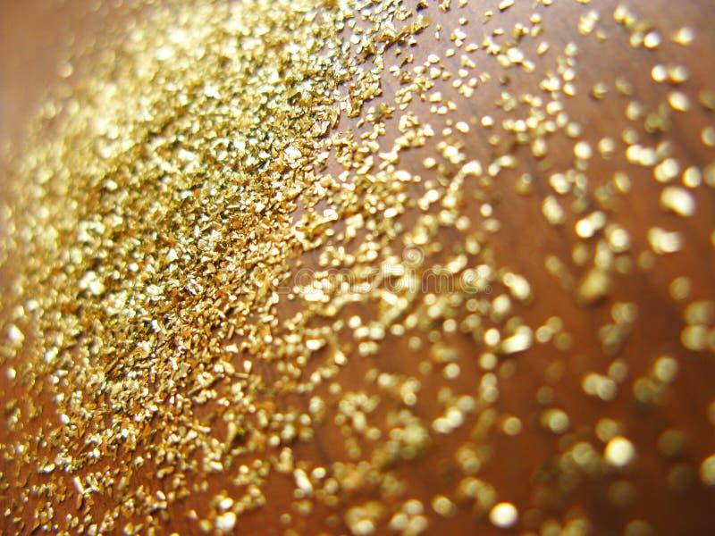 Gouden poeder royalty-vrije stock afbeeldingen