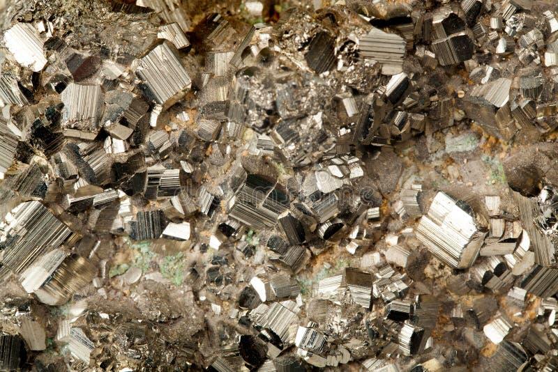 Gouden pyrietmineraal stock afbeelding