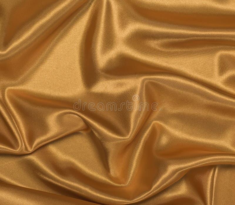 Gouden Satijn Gedrapeerde Achtergrond royalty-vrije stock afbeelding