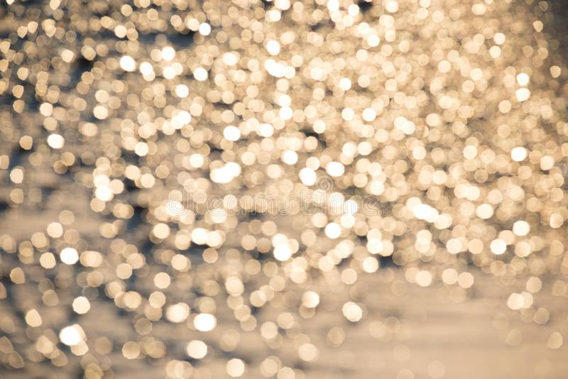 Gouden schitter achtergrond - strandzand stock foto
