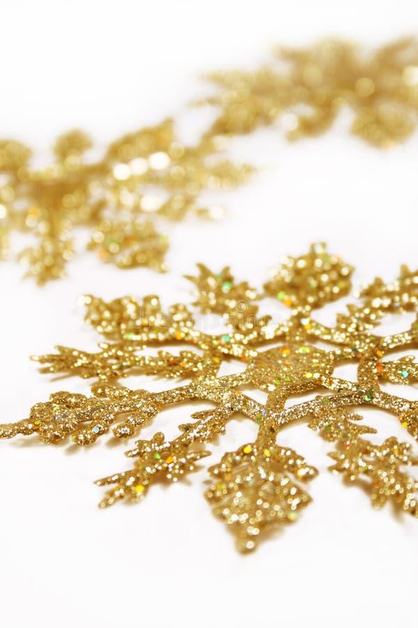 Gouden sneeuwvlokken stock afbeeldingen