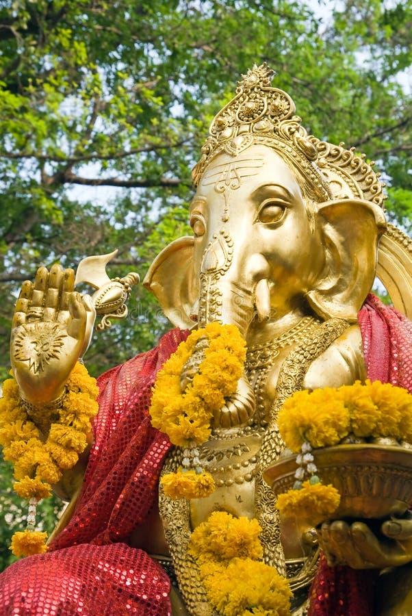 Gouden standbeeld van Ganesha stock fotografie