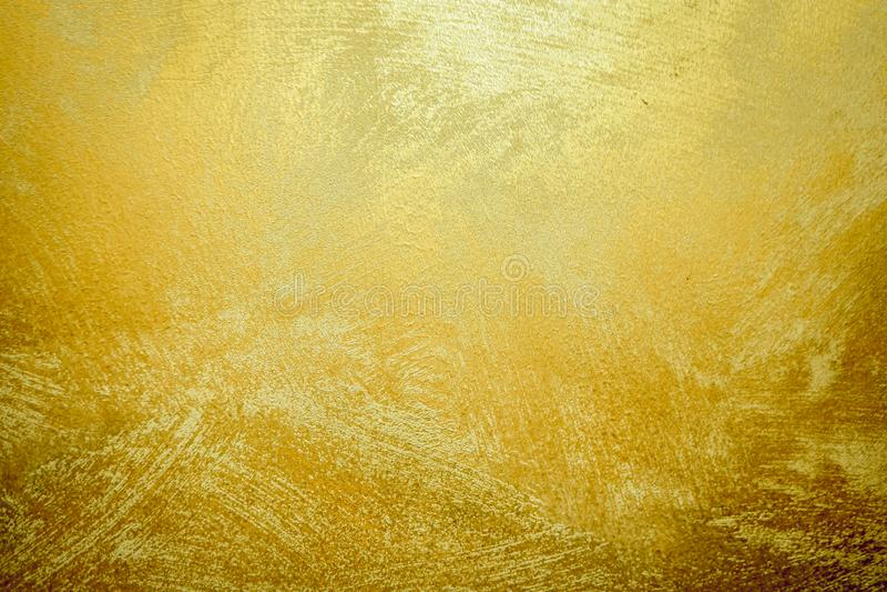 Gouden Steenachtergrond en Gradiëntenschaduw Mooie Heldere Messingsmuur voor Document Decoratieelement Glanzend Geel Gouden Blad royalty-vrije stock foto